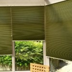 Sage green duette pleated freehanging blinds in a Victorian conservatory.