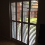 Full height shutters doors to cover patio doors, installation in Rugby